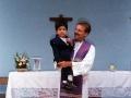 O. Zbigniew po mszy świętej z chłopcem